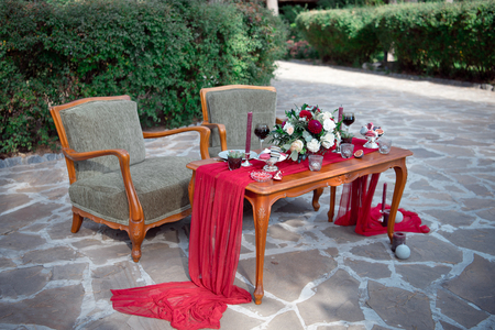 Romantic Table For Two With Fresh Flowers And Candles On An Outdoor Garden  Patio Set With