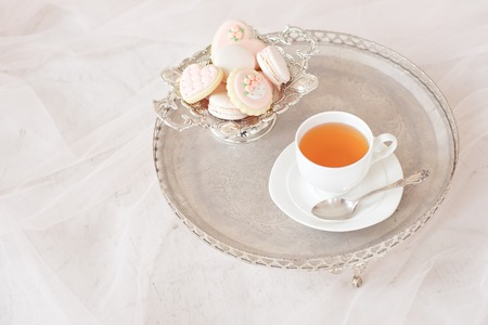 silver tray with cup of tea and macaroons top view Stock Photo