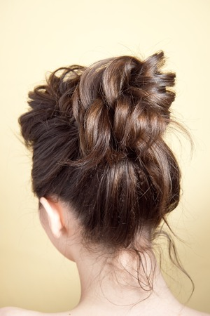 Rear view of female hairstyle volume braid.