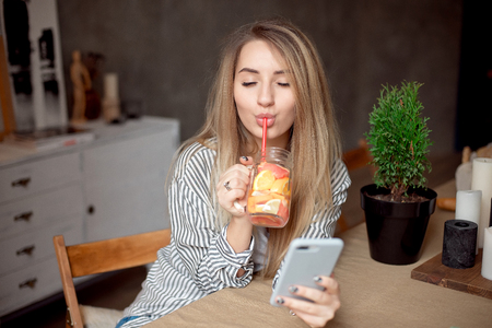 Young woman enjoing with fresh summer lemonade