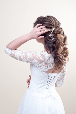 Model with perfect fashion makeup and hairstyle unrecognizable rear view.