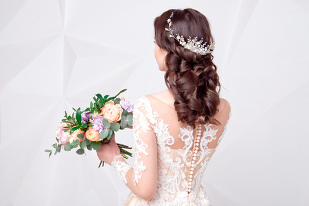 Female Elegant wedding hairstyle for the wedding, unrecognizable rear view.