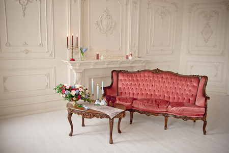 baroque style interior with red luxury sofa and table