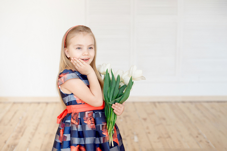 Portrait of little smiling girl child in colorful dress Stock Photo