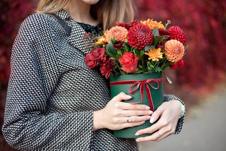 Close-up flower-box in woman hands as a gift concept for wedding, birthday, event, celebration, flowers delivery, surprise