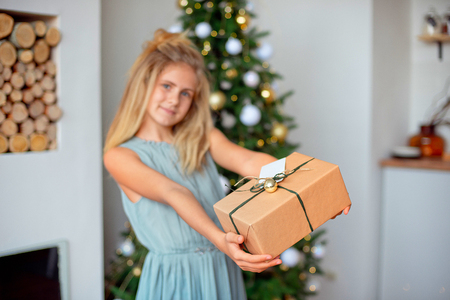 Holidays, presents, christmas, x-mas concept - happy girl with gift box.