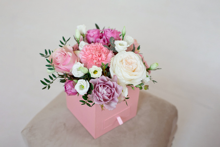 Beautiful spring bouquet with tender flowers in box.