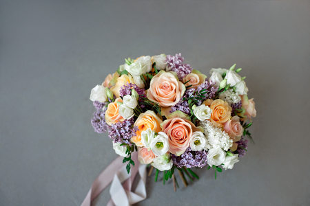 Close-up bouquet of flowers on the round white table indoors