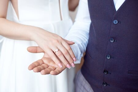 Bride and groom. Bride and groom holding hands
