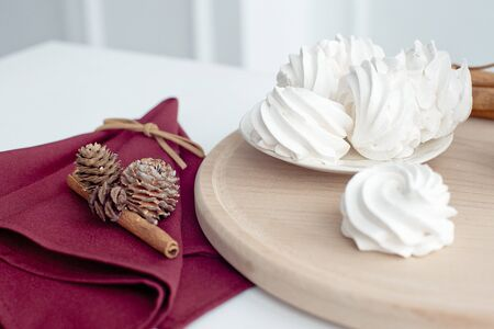 Marshmallow on a plate, white meringue marshmallow background. Flat lay. View from above. Berry sweet homemade marshmallows on a wooden stand. Traditional Russian white homemade marshmallows