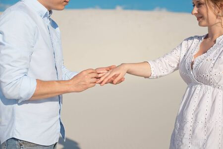Close-up man and woman hand touching holding together on blurred background for love and healing concept