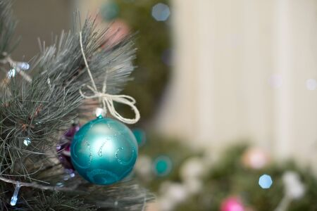 Christmas tree branches balls decoration New Year with bokeh lights on background.
