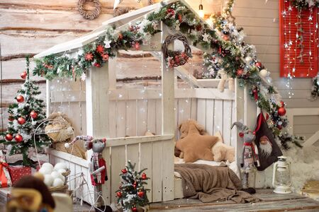 Beautiful holdiay decorated room with Christmas tree with presents under it - Image. Christmas home interior in red blue tones. Фото со стока