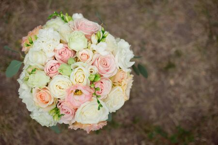 Top view of a beautiful delicate wedding bouquet of cream roses and eustoma. 版權商用圖片