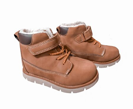 Cute children's winter shoes isolated on a white background. Use in children's catalogs of clothes and shoes, promotional items. Foto de archivo