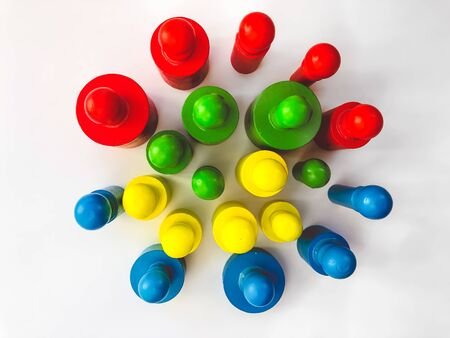 Colorful bright educational toys in the form of cylinders for children. Bright colorful background. Designed for educational centers for children, for children's stores. The concept of training.