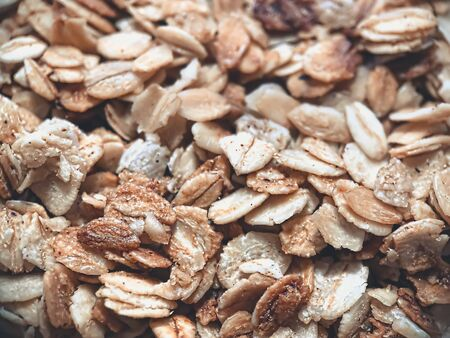 Close-up of granola, breakfast dish, snack. On the photo is a granule of oatmeal and honey. Application in the packaging of products as well as banners and articles for websites.