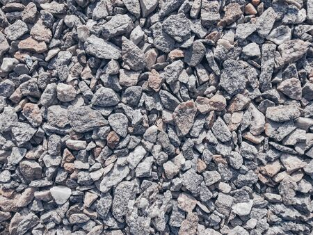 Crushed stone lying on the ground texture. Photos of minerals, crushed stone background, crushed stone texture