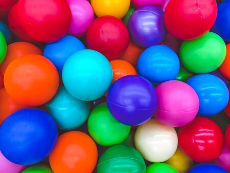Bright multi-colored balls for the pool for childrens games. Toys for children, entertainment for kids. Use in catalogs of childrens stores, advertising entertainment centers. Bright multi-color background