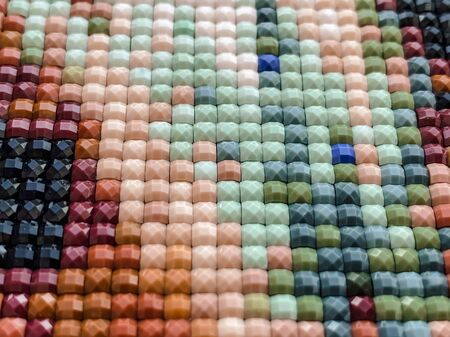 Close-up, colorful square diamond embroidery bright. Hobbies and entertainment.