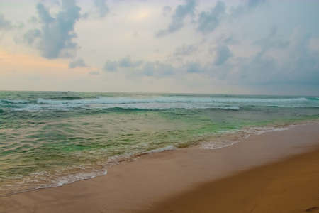 Sea view off the coast of the Indian Ocean in Hikkaduwa, Sri Lanka. The concept of leisure and tourism.