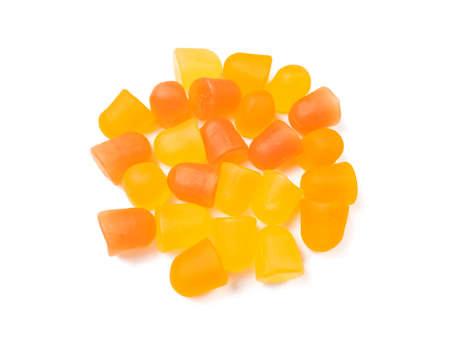 Close-up texture of orange and yellow multivitamin gummies. Healthy lifestyle concept. Archivio Fotografico