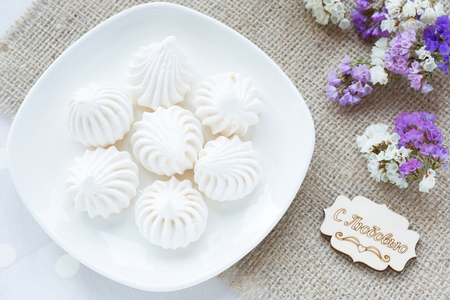 Meringue - the Traditional French dessert on a light background close up, the top view
