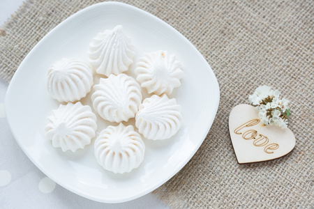 sacking: Meringue - the Traditional French dessert on a light background close up, the top view