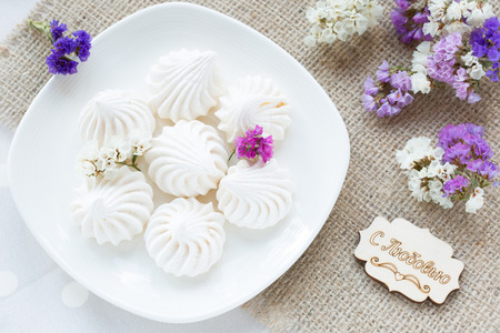 traditional french: Meringue - the Traditional French dessert on a light background close up, the top view