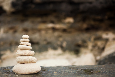 massage symbol: Zen stones, background ocean for the perfect meditation