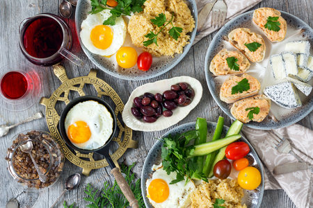 Food, healthy Breakfast, porridge, eggs, vegetables and sandwiches with caviar