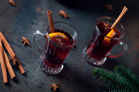 Top view of Traditional winter mulled wine in vintage glass on a metallic background, selective focus and toned image. Sangria on bar table. Celebration with spicy cocktail.