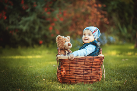Happy little boy playing with a toy. Children enjoying activity outdoor. Childhood, baby, holiday, people, hobby concepts. Foto de archivo