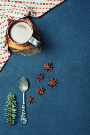 Frame of the Cup of Cacao Coffee Beans Cinnamon sticks Spoon and Fir. Kitchen Ingredients Winter or Autumn Composition. Flat lay Top view Copy Space Vertical Stock Photo