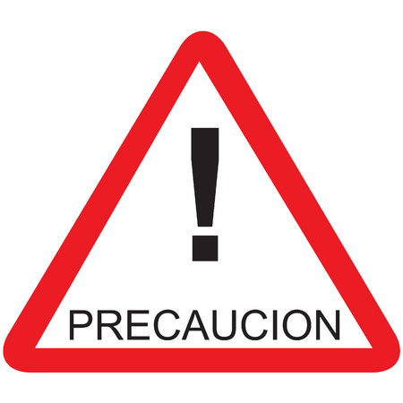 Red triangle road sign with spanish text caution isolated