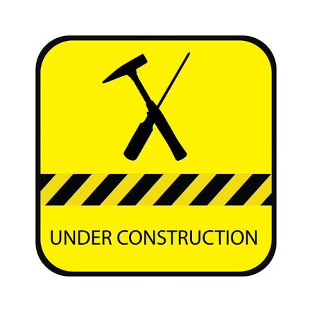 Yellow under construction road sign, with screwdriver, hammer and text under construction