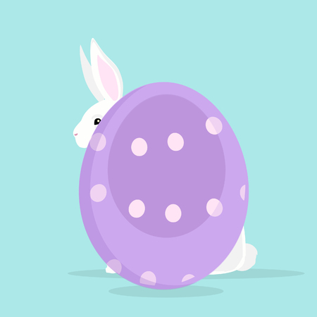 Cute rabbit with painted Easter egg