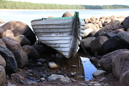 ladoga: Boat in the rocks near the shore of Lake Ladoga Stock Photo