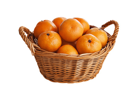 Ripe, juicy tangerines are in a wooden basket, isolated on white background