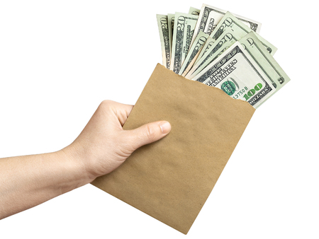 Envelope with dollars in a hand