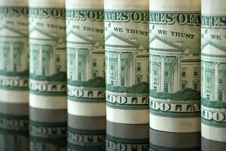 american currency: Many US dollars in the form of tubes Stock Photo