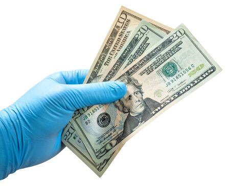 Hand in disposable glove isolated on white. Money in hand.