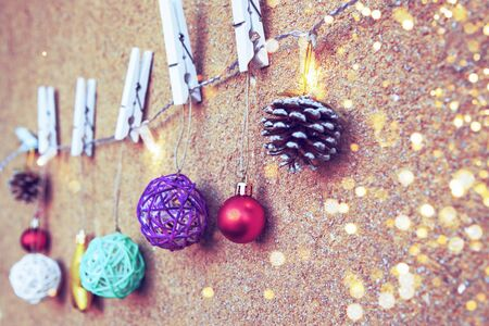 Christmas and New Year decoration with a garland on a beige wall background, shallow depth of field.