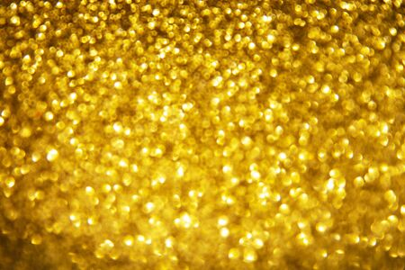 Golden abstract bokeh background, texture. Lights festive background concept.
