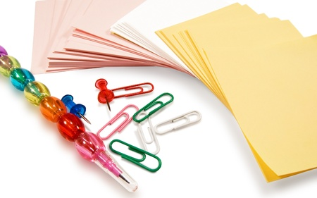 clerical: stickers, a pencil and paper clips on white background