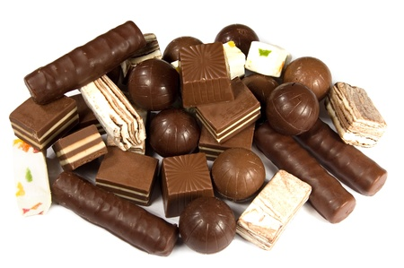 Assorted chocolates on a white background