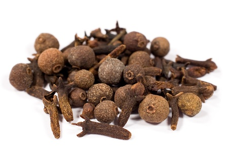 allspice: allspice and cloves on white background close-up