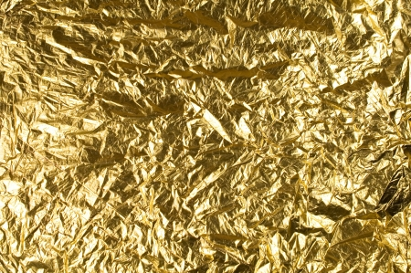 foil: background with a gold foil for the design Stock Photo