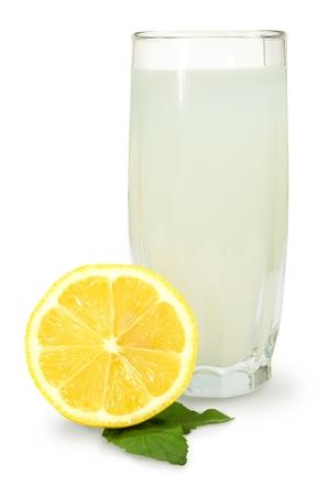 lemon juice: lemon- mint drink and fresh lemon on a white background