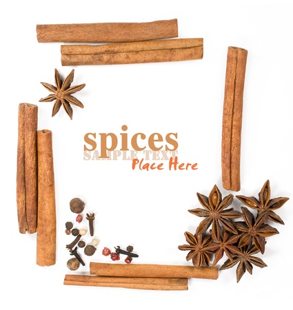 Frame with cinnamon sticks and star anise on white background
